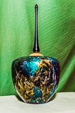 Hollow form with tall finial using air blown acrylic paint finish.