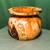 Vase form in heavily figured Yew.
