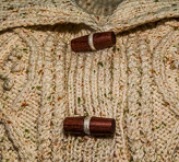 Christine created this heavy knit cardigan - and turned the toggles.