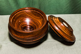 Roy converted this Lignum Vitae bowling ball into a lidded dish - work in Progress.