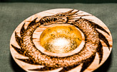 Wide rimmed dish with gold gilded bowl and pyrography design on the rim. Pyrography by Tino.