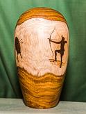 Laburnum hollow form Archery Club Trophy.  Pyrography by Lesley Wyatt. Base with winners shields and finial to follow...