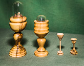 Sets of miniature goblets - some with captive rings.