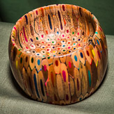 Bowl constructed entirely from coloured pencils.