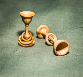 Miniature goblets with multiple captive rings.  Approx 1inch tall.