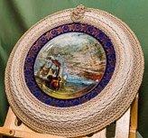 Sea themed plate mounted in mdf ring and finished with 7 rings of ropework.