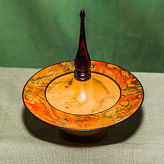Dish with marbled rim and tall finial