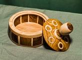 Lidded box with inlays and segmentation - in Hornbeam, Oak and Laburnum.