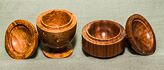Lidded boxes with finials in spalted Walnut and Walnut.