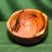 Yew bowl with inlays and gold metallic finish.