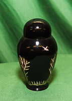 Lidded box in sycamore with black/golf carved design and lacquered finish.