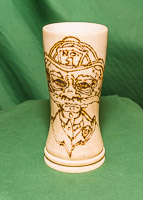 Colin made the vase - Betty then completed the pyrography decoration.