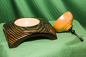 Four cornered form with gold and black finish, contrasting lid and ebony finial.