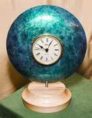 Clock with Ash body and Maple base - coloured with Jo Sonja's 'Iridescent colour'.